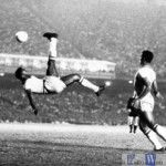 Brazil's soccer star Pele kicks the ball over his head during a game in Sept. 1968, location unknown.  (AP Photo)